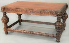 Victorian oak library table, having carved edges and