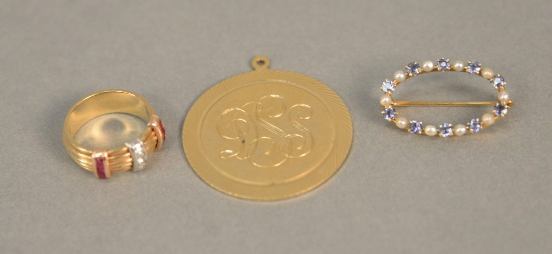 Three piece lot to include 14K gold oval pin and ring s