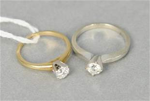 Two 14 karat yellow gold and diamond engagement rings,