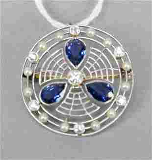 Platinum circular brooch set with three tear drop blue