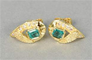 Pair of gold, emerald, and diamond earrings centering