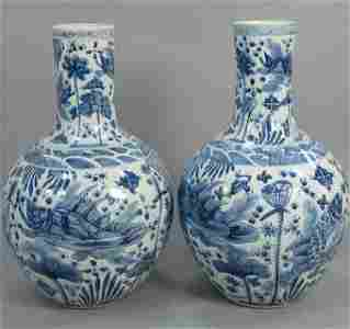 Pair large blue and white vases depicting fish, one