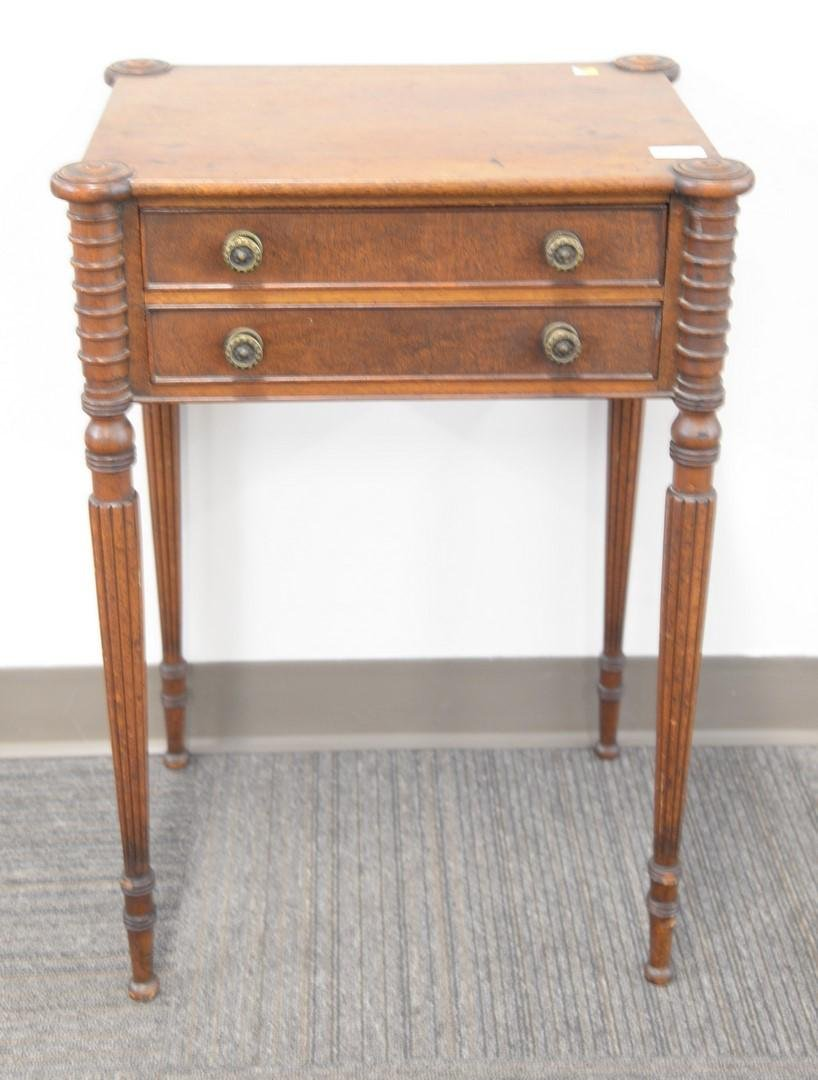 Sheraton mahogany two drawer stand with turret corners,