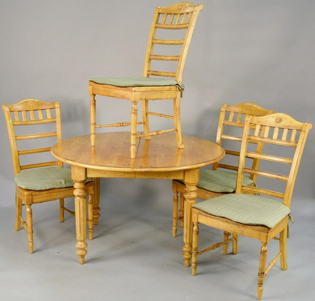 Five piece dining set with round pine table, 1 leaf,