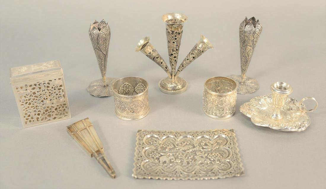 Nine-piece silver lot to include vases, candleholder,