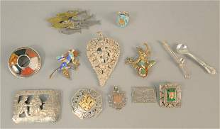 Ten silver pins, two with enamelling, one with gold