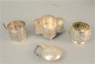 Four-piece silver lot to include mug with handle,