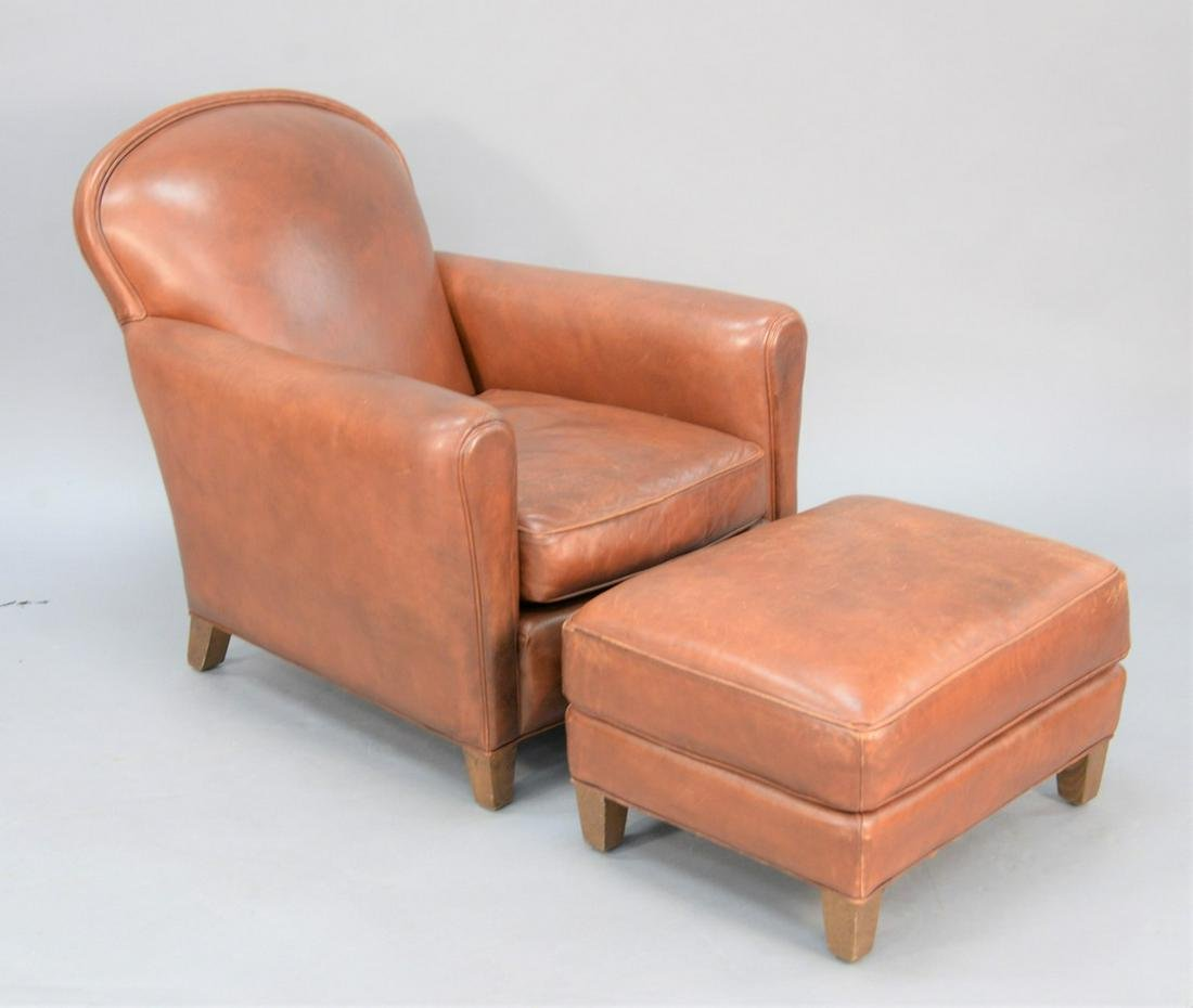 Two-piece lot to include leather chair with ottoman,