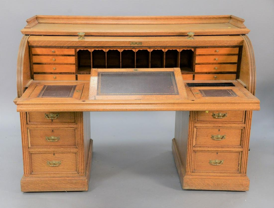 Large oak roll-top desk with fitted interior and