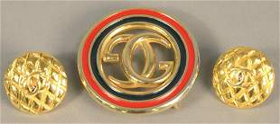 Three piece lot to include two Gucci belt buckles along