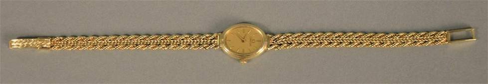 14K gold Omega ladies wristwatch oval with 14K