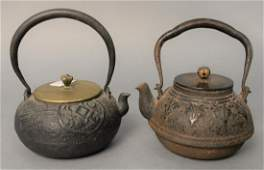 Two early Japanese iron and bronze teapots, one with