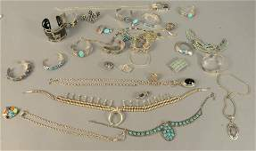 Large group of sterling silver jewelry most mounted