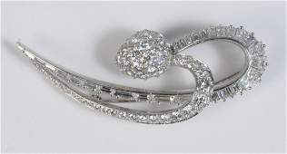 Platinum Brooch in a Double Swirl with a Pear Shape