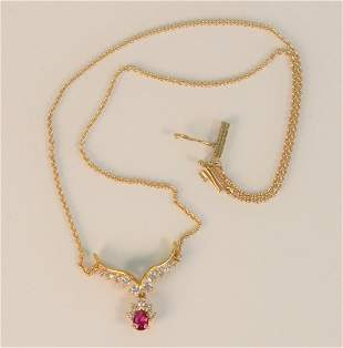 14 Karat Yellow Gold Chain with Pendant set with ruby
