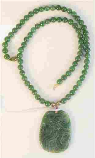 Green jade bead necklace with carved green jade