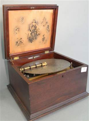 "Regina Music Box 11"" disc player, in mahogany case"