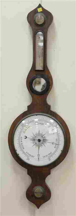 Mahogany Barometer with porcelain dial.