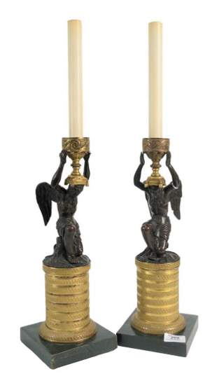 Pair of Bronze Candlesticks having a winged bronze man