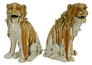 Pair of Porcelain Foo Dogs in a white and brown glaze,