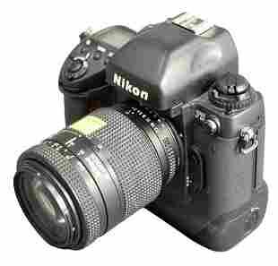 Nikon F5 35mm Camera, along with a AF Nikkor 1:3.5 -