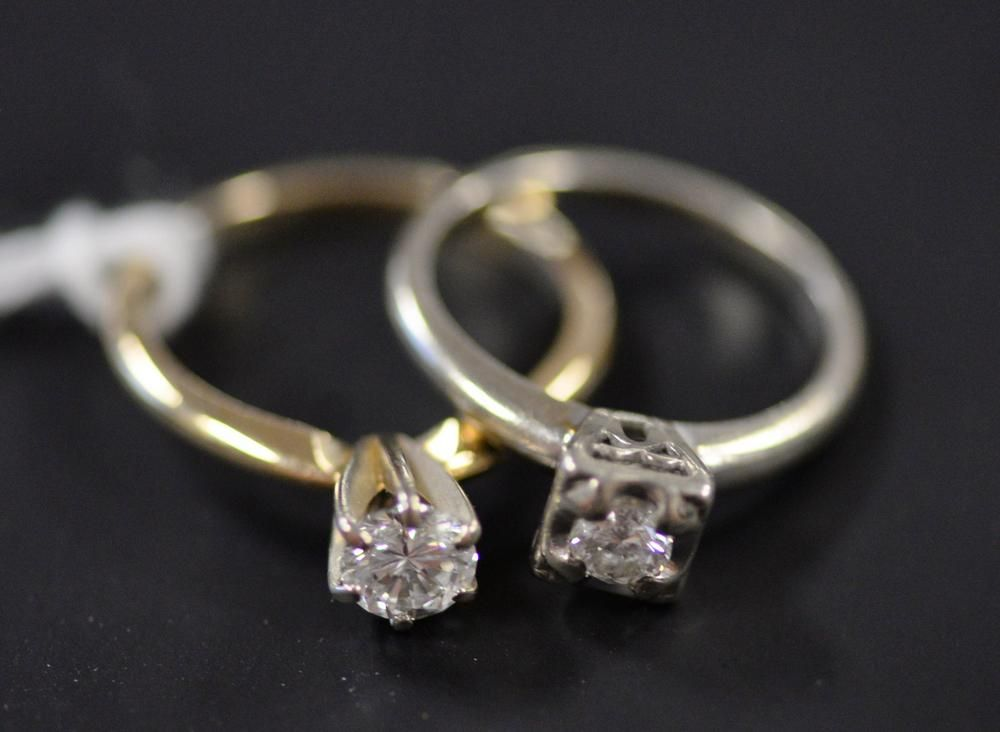 Two Rings to include, 14 karat gold ring set with