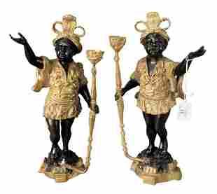 Pair of Bronze Blackamoor Figures, each holding a