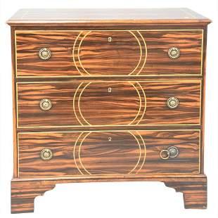 Modern History Three Drawer Chest, having exotic wood