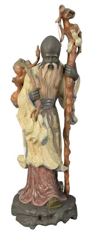 Large Lladro Porcelain Oriental Figure, having a staff