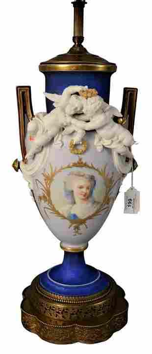 French Porcelain Figural Urn, having basalt putti
