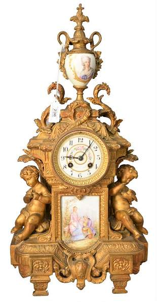 French Style Figural Mantle Clock, having two putti