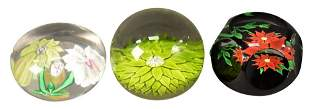Three Saint Louis Glass Paperweights, having floral