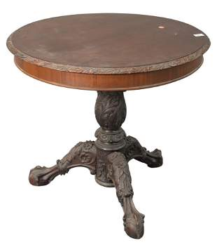 Round Occasional Table, having carved top over heavily