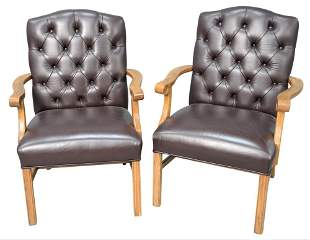 Pair of Oak Arm Chairs, having brown leather