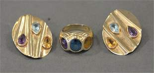 Three Piece 14 Karat Gold Group, pair of earrings and a