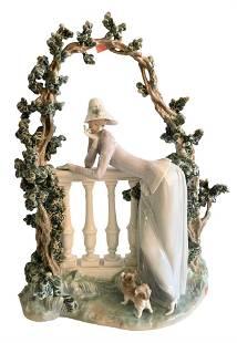 Large Lladro Porcelain Figure, having a figure leaning