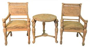Four Piece Egyptian Revival Set, having two armchairs,