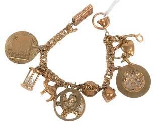 14 Karat Gold Charm Bracelet, having 12 charms, 9