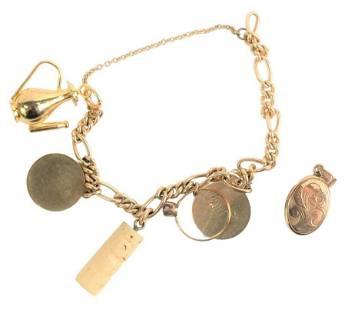 14 Karat Yellow Gold Charm Bracelet, having 14 karat