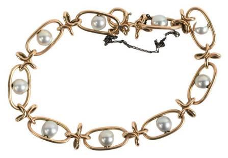 14 Karat Yellow Gold Bracelet, having nine pearls, 10.3