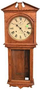 "Seth Thomas ""Umbria"" Wall Clock, having oak case with"