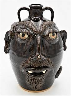 """Stoneware Face Jug, signed to the underside """"JS"""