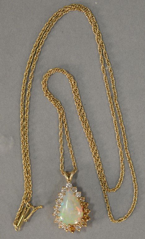 14K gold chain and pendant with teardrop opal