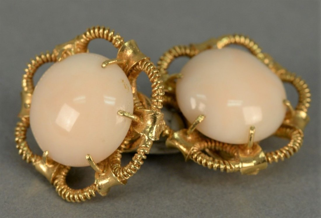 18K clip on earrings, each set with large cabochon cut