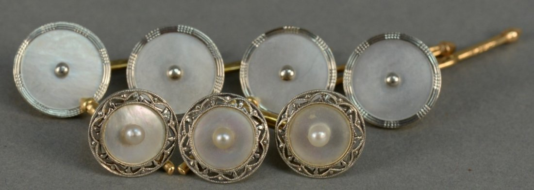 Seven piece gold and mother of pearl cufflink and
