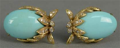 Pair of 14K gold clip earrings each set with oval