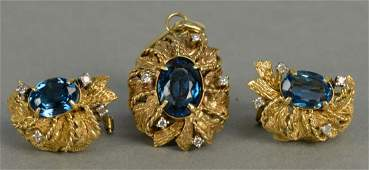 Three piece 14K gold set with pendant and matching