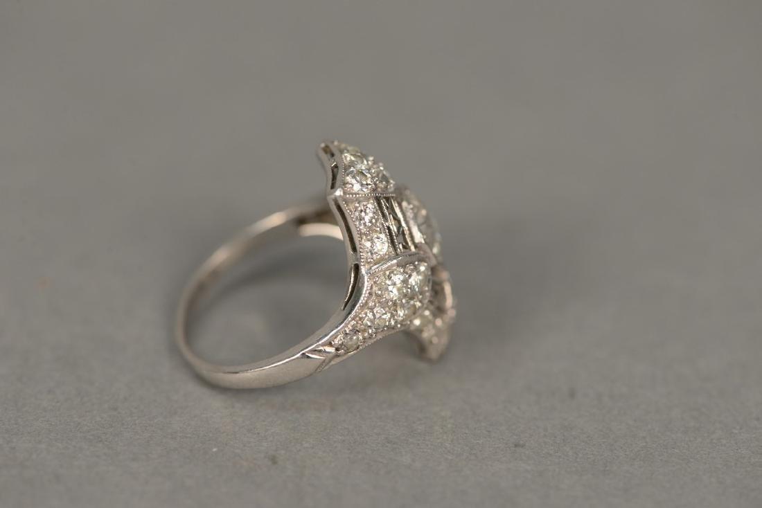 Platinum and diamond ring having center diamond - 10