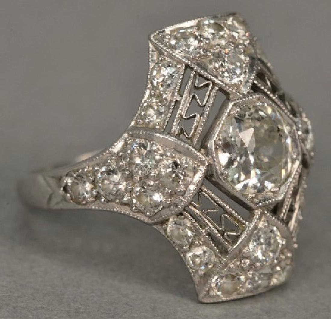 Platinum and diamond ring having center diamond