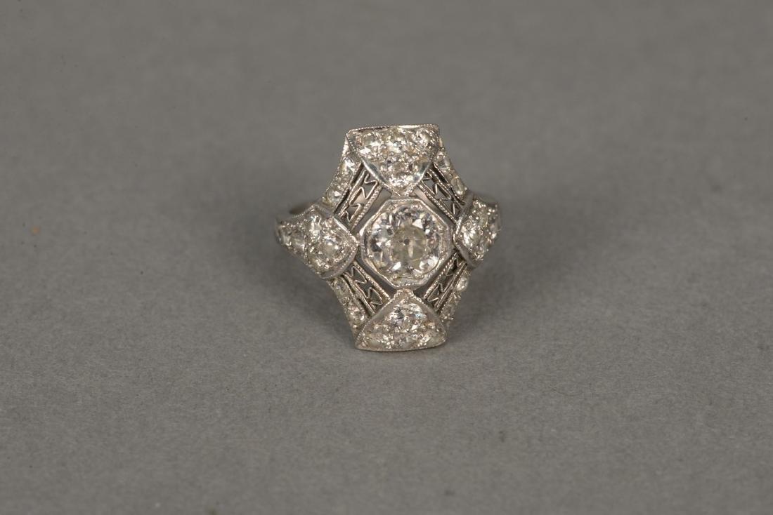Platinum and diamond ring having center diamond - 5